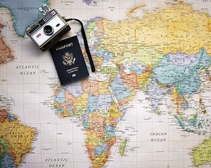 Travel Picture with a passport and camera