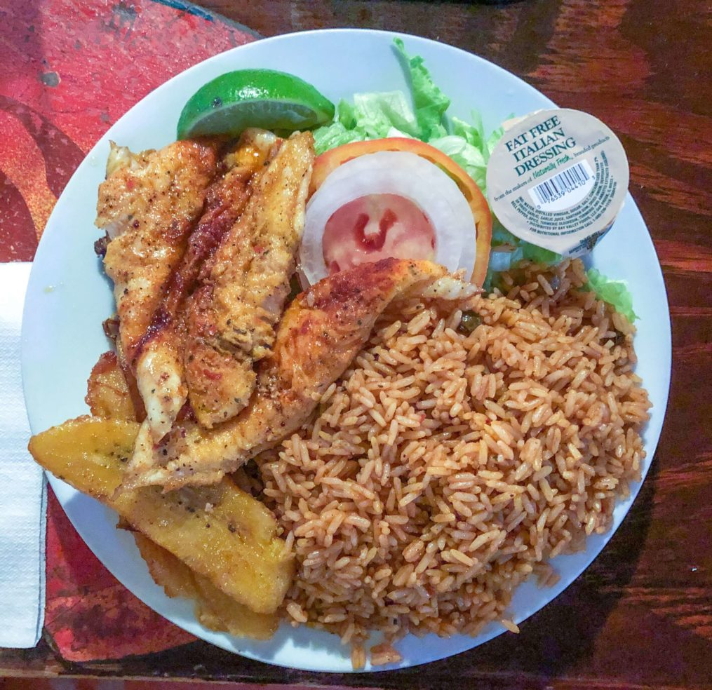 Spicy grilled fish, fried plantains, and peas and rice in the Bahamas