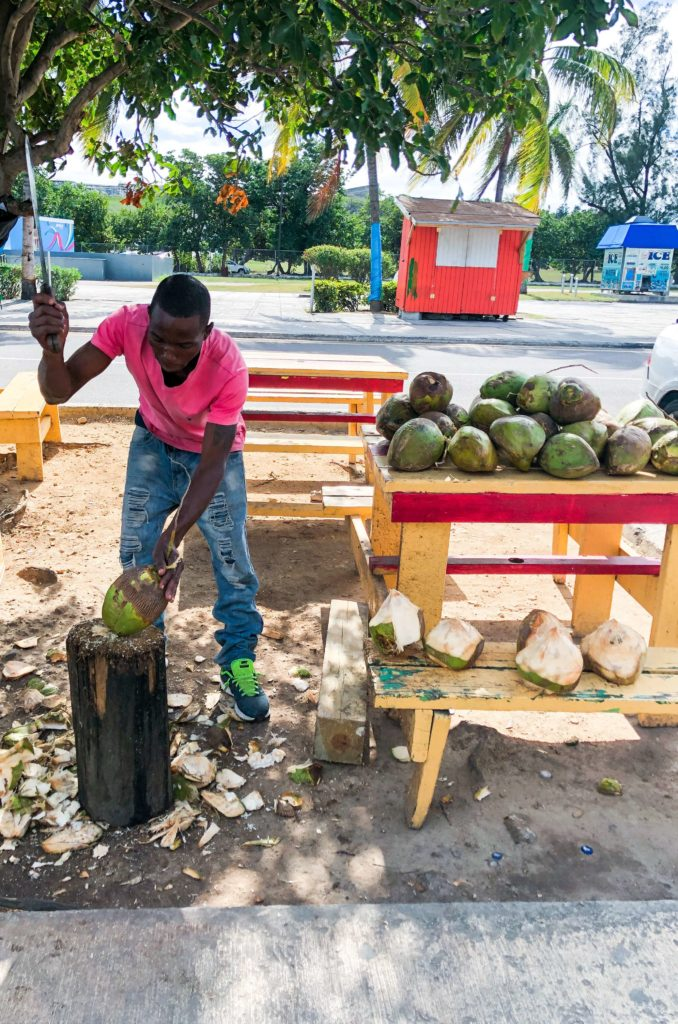 A man slicing coconuts in Bahamas